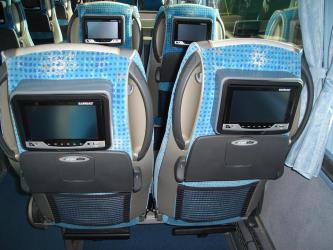 Bus interior showing entertainment system in seat back